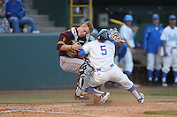Brian Serven #6 of the Arizona State Sun Devils holds onto the ball for a out at home plate while being run into by Kevin Williams #5 of the UCLA Bruins during a game at Jackie Robinson Stadium on March 28, 2014 in Los Angeles, California. UCLA defeated Arizona State 7-3. (Larry Goren/Four Seam Images)