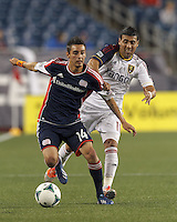 New England Revolution midfielder Diego Fagundez (14) controls the ball as Real Salt Lake midfielder Javier Morales (11) pressures. In a Major League Soccer (MLS) match, Real Salt Lake (white)defeated the New England Revolution (blue), 2-1, at Gillette Stadium on May 8, 2013.