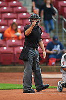 Umpire Arturo Gonzalez makes a call during a game between the Kane County Cougars and Cedar Rapids Kernels on August 18, 2015 at Perfect Game Field in Cedar Rapids, Iowa.  Kane County defeated Cedar Rapids 1-0.  (Mike Janes/Four Seam Images)