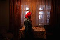 Natasha stands inside her farmhouse in the village of Chobruchi, Transnistria on 16 April 2009.