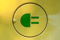 Milano, microcar elettrica della cinese ZD per il car sharing Share'ngo. Bocchettone con il simbolo di una spina di corrente --- Milan, chinese-made ZD electric microcar of car sharing Share'ngo. Plug symbol