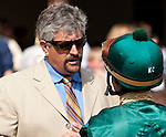 March 2010:  Trainer Steven Asmussen, left, talks with jockey John Jacinto before the New Orleans Handicap at the Fair Grounds in New Orleans, La.