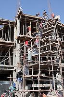 Kathmandu, Nepal.  Construction Crew, Passing Cement Upwards by Hand.