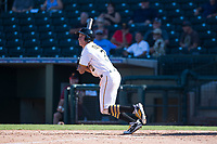Surprise Saguaros shortstop Cole Tucker (2), of the Pittsburgh Pirates organization, follows through on his swing during an Arizona Fall League game against the Salt River Rafters on October 9, 2018 at Surprise Stadium in Surprise, Arizona. Salt River defeated Surprise 10-8. (Zachary Lucy/Four Seam Images)