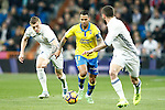 Real Madrid's Toni Kroos (l) and Daniel Carvajal (r) and UD Las Palmas' Jonathan Viera during La Liga match. March 1,2017. (ALTERPHOTOS/Acero)