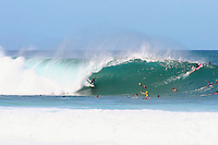 A surfer rides the barrel at Pipeline on Oahu's North Shore.