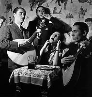 Toni Frissell: Fado singer in Portuguese night club, Lisbon, 1946