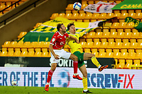 2nd January 2021; Carrow Road, Norwich, Norfolk, England, English Football League Championship Football, Norwich versus Barnsley; Herbie Kane of Barnsley competes for the ball with Kieran Dowell of Norwich City
