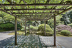 Under the Arbor, Portland, Oregon,Japanese Garden.  The Japanese Garden in Portland is a 5.5 acre respit.  Said to be one of the most authentic Japanese Garden's outside of Japan, the rolling terrain and water features symbolize both peace and strength. This image available for license through exclusive agency.  Please contact the photographer