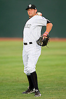 Grand Junction Rockies starting pitcher Matt Carasiti (45) warms up in the outfield prior to the game against the prior to the game against the Billings Mustangs at Suplizio Field on July 24, 2012 in Grand Junction, Colorado.  The Rockies defeated the Mustangs 4-3.  (Brian Westerholt/Four Seam Images)