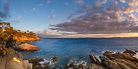"Colorful golden sunset on Pointe Layet"" rocks, the Mediterranean Sea and Port Cros"" national park island, near le Lavandou, Azure coast France"