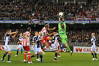 MELBOURNE, AUSTRALIA - MAY 19: Lawrence Thomas of the Victory catches the ball during a match between Melbourne Victory and Olympiakos FC at Etihad Stadium on 19 May 2012 in Melbourne, Australia. (Photo Sydney Low / AsteriskImages.com)