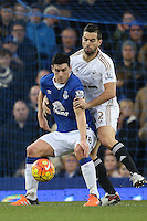 Gareth Barry competes with Jordi Amat  during the Barclays Premier League match between Everton and Swansea City played at Goodison Park, Liverpool