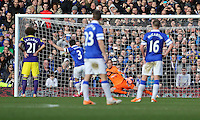 Pictured: Gerhard Tremmel of Swansea (in ornage) concedes a goal from a penalty kick taken by Leighton Baines of Everton (3). Sunday 16 February 2014<br /> Re: FA Cup, Everton v Swansea City FC at Goodison Park, Liverpool, UK.