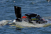 """Frame 4: Jay Gignac, GNH-55 """"Gi Wizz"""" returns to the pits with the left sponson blown out and damage to the right.  (Grand National Hydroplane(s)"""