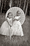 Cute bridesmaids and paper umbrellas in a field of aspens in Steamboat Colorado.