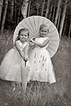 Cute bridesmaids and paper umbrellas in a field of aspens in Steamboat Colorado.