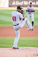 Braulio Lara (48) of the Sacramento River Cats delivers a pitch to the plate against the Salt Lake Bees in Pacific Coast League action at Smith's Ballpark on April 20, 2015 in Salt Lake City, Utah.  (Stephen Smith/Four Seam Images)