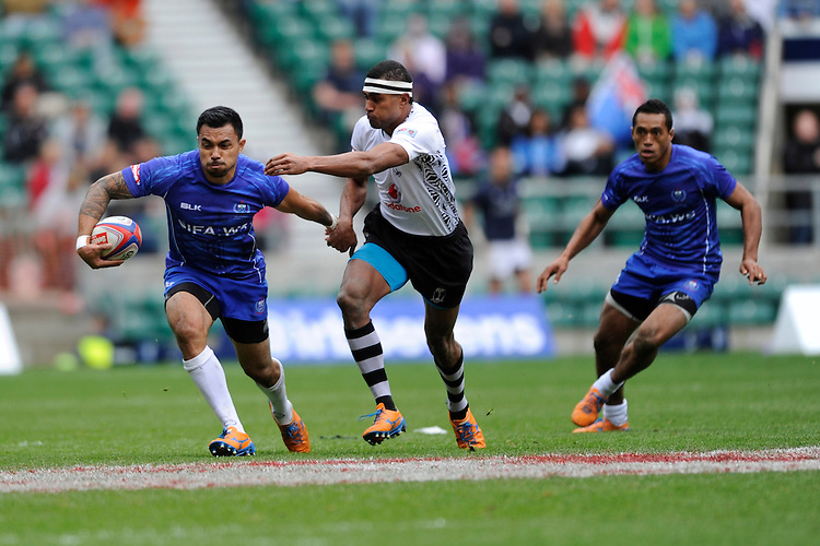 Fautua Otto of Samoa in action against Apisai Domolailai of Fiji during Day Two of the iRB Marriott London Sevens at Twickenham on Sunday 11th May 2014 (Photo by Rob Munro)
