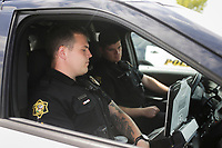 Springdale Police Officers Trevor Bowen (from left) and Nick Stone sit in a police vehicle, Friday, July 16, 2021 at the Springdale Police Station in Springdale. The supply chain that has limited the amount of new cars for sale will hit the police departments as they try to replace patrol cars. Officials say they must make do with what they have. Check out nwaonline.com/210717Daily/ for today's photo gallery. <br /> (NWA Democrat-Gazette/Charlie Kaijo)