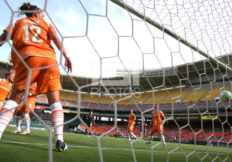 Cat Whitehill #4 of Washington Freedom (out of the picture) sends the ball past Meghan Schnur #12 of Sky Blue FC and into the net for the Freedom's first goal during a WPS match at RFK Stadium on May 23, 2009 in Washington D.C. Freedom won the match 2-1