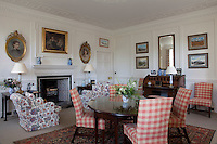 A cheerful living room, modist in comparison to some of the grander rooms of the house