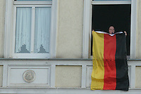 In Erfurt, Germany a German national soccer team supporter waves a German flag and blows a whistle as cars driving buy celebrate Germany's win over Argentina by waving German flags and honking their horns.  Germany and Argentina played their 2006 FIFA World Cup Quarterfinal match on Friday, June 30th, 2006. Germany defeated Argentina on penalty kicks 3-1 to advance to the semi-finals.