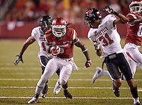 NWA Democrat-Gazette/BEN GOFF @NWABENGOFF<br /> Alex Collins, Arkansas running back, evades Texas Tech safety Keenon Ward (15) and cornerback Justis Nelson in the fourth quarter on Saturday Sept. 19, 2015 during the game in Razorback Stadium in Fayetteville.