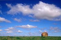 Single bale of hay in huge prarie field, Winnipeg, Manitoba, Canada