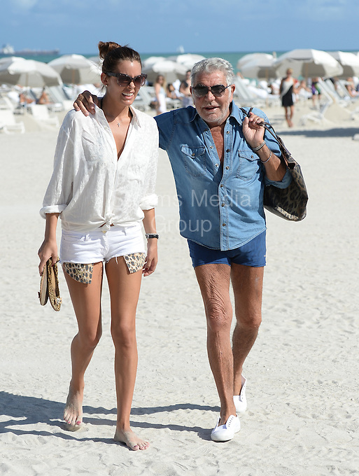 SMG_Roberto Cavalli_Lina Nilson_FLXX_Shirtless_120713_01.JPG<br /> <br /> MIAMI BEACH, FL - DECEMBER 07: Roberto Cavalli and girlfriend  brunette beauty Lina Nilson.  Roberto Cavalli  (born 15 November 1940) is an Italian fashion designer from Florence on December 7, 2013 in Miami, Florida.  (Photo By Storms Media Group)<br /> <br /> People:  Roberto Cavalli_Lina Nilson<br /> <br /> Transmission Ref:  FLXX<br /> <br /> Must call if interested<br /> Michael Storms<br /> Storms Media Group Inc.<br /> 305-632-3400 - Cell<br /> 305-513-5783 - Fax<br /> MikeStorm@aol.com<br /> www.StormsMediaGroup.com