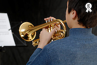 Boy (9-11) practising trumpet, close-up, rear view (Licence this image exclusively with Getty: http://www.gettyimages.com/detail/73532520 )