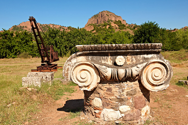 Ionic capital of the Temple of Artimis with the crane brought to Sardis in 1911 by the Howard Crosby Expedition used to lift fallen architectural blocks of the Temple of Artimis. Made by Dorman & Long Middlesborough, England. Sardis archaeological site, Hermus valley, Turkey.