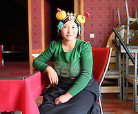 A Tibetan woman in a restaurant in the Amdo region of the Tibetan Plateau. Up to 100,000 nomads have been removed from the highland grasslands of the Tibetan Plateau. Climate change, mining and government policy are causing the rapid disappearance of this unique culture.