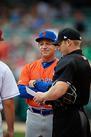 Syracuse Mets manager Tony DeFrancesco (11) during the lineup exchange with umpire Travis Godec before an International League game against the Indianapolis Indians on July 16, 2019 at Victory Field in Indianapolis, Indiana.  Syracuse defeated Indianapolis 5-2  (Mike Janes/Four Seam Images)