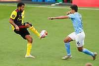 Troy Deeney of Watford and Rodri of Man City during the Premier League match between Watford and Manchester City at Vicarage Road, Watford, England on 21 July 2020. Football Stadiums around remain empty due to the Covid-19 Pandemic as Government social distancing laws prohibit supporters inside venues resulting in all fixtures being played behind closed doors until further notice.<br /> Photo by Andy Rowland.