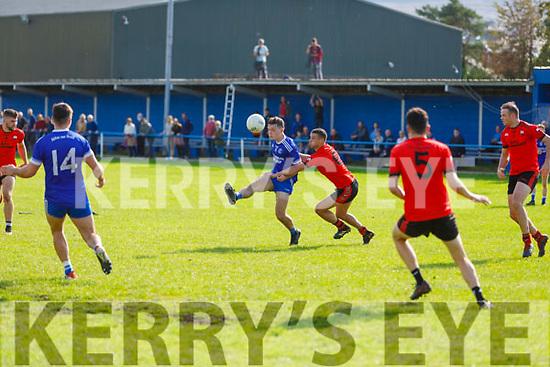Killian Falvey of Annascaul tries to get his effort way under pressure from Shane Enright of Tarbert in the Junior Club Football Championship semi final.