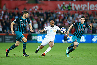 Andre Ayew of Swansea City breaks through the middle of Jeremy Pied and Pierre-Emile Hojbjerg of Southampton during the Premier League match between Swansea City and Southampton at Liberty Stadium, Swansea, Wales, UK. Tuesday 08 May 2018