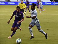 KANSAS CITY, KS - SEPTEMBER 23: #2 Ruan of Orlando City SC attempts to block #12 Gerso Fernandes of Sporting Kansas City as he drives the ball down the wing during a game between Orlando City SC and Sporting Kansas City at Children's Mercy Park on September 23, 2020 in Kansas City, Kansas.