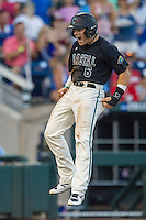 Coastal Carolina Chanticleers outfielder Connor Owings (6) celebrates scoring a run against the Florida Gators in Game 4 of the NCAA College World Series on June 19, 2016 at TD Ameritrade Park in Omaha, Nebraska. Coastal Carolina defeated Florida 2-1. (Andrew Woolley/Four Seam Images)