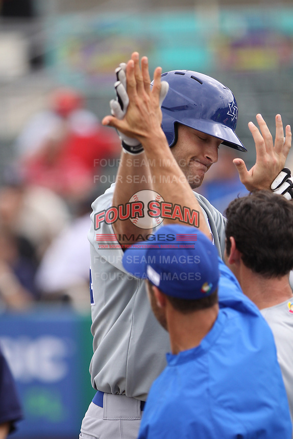 Nate Freiman of Team Israel is congratulated by teammates during a game against Team Spain during the World Baseball Classic preliminary round at Roger Dean Stadium on September 21, 2012 in Jupiter, Florida. Team Israel defeated Team Spain 4-2. (Stacy Jo Grant/Four Seam Images)