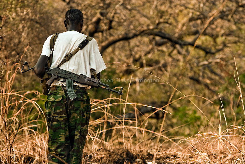 Sudanese People's Liberation Army soldier. Mugale/Nimule Road, Magwi County, Sudan, Africa. December 2005 © Stephen Blake Farrington