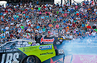Sep 26, 2020; Gainesville, Florida, USA; General view of NHRA fans in the grandstands as funny car driver Tim Wilkerson goes past during qualifying for the Gatornationals at Gainesville Raceway. Mandatory Credit: Mark J. Rebilas-USA TODAY Sports