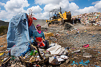 Nicaragua, Granada. Single women who are abandoned by their husbands or widowed are left to care for their children on their own need to find a way to care for their families. They gather recycling in massive garbage dumps for $1.00 a day.