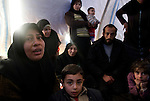 Still in shock, Fatma Um Mahmoud and her family had just arrived in Azaz Camp, fleeing Aleppo after what they believe was a scud missile that hit very near their neighborhood the day before, at Azaz Camp, just inside the Syrian border with Turkey, Feb. 24, 2013. Um Mahmoud said they bid farewell to their friends, and learned of yet another scud missile attack in the same area, which they believe killed many of their friends and neighbors. The family wants to go to Turkey, but there is no more room at the Turkish refugee camp on the other side of the border, so they must wait for a place. According to administrators, this camp holds roughly 9,000 to 10,000 internally displaced persons (IDP's). Two meals per day are provided by a Turkish humanitarian organization, and Qatar Red Crescent provided tents. There is very little electricity, and no running water. There is also a refugee camp on the Turkish side of the border, but it is full. The UN Refugee Agency has reported a sharp increase in refugees fleeing Syria for neighboring countries in the first months of 2013.