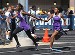 Silverado's Jasmyn Garcia hands off to Amari Norris during the 4x200 womens relay at the Nevada State Track and Field Championships at Damonte High School in Reno, Nev., on Saturday, May 19, 2012. Silverado's team won the event with a time of 1:41..Photo by Cathleen Allison
