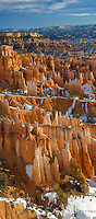 Vertical Panorama of the hoodoos of Bryce Amphitheater, Bryce Canyon National Park, Utah. Hoodoos are pinnacles or odd-shaped rocks left standing by the forces of erosion. Technically not a canyon, most of the erosion at Bryce comes from the freezing and thawing of water, a frequent occurence due to its high elevation of approximately 7,000 to 9,000 feet (2,133 - 2,743 m). In addition to ice, wind and water erosion also play a role.