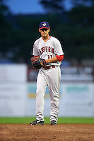 Auburn Doubledays pitcher Luis Torres (11) gets ready to deliver a pitch during a game against the Batavia Muckdogs on July 8, 2015 at Dwyer Stadium in Batavia, New York.  Batavia defeated Auburn 4-1.  (Mike Janes/Four Seam Images)
