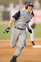 Lake County catcher Matt McBride (24) hustles into third base with a triple in the first inning of play versus Kannapolis at Fieldcrest Cannon Stadium in Kannapolis, NC, Saturday, August 11, 2007.
