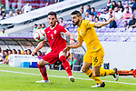 Aziz Behich of Australia (R) fights for the ball with Yousef Rawshdeh of Jordan (L) during the AFC Asian Cup UAE 2019 Group B match between Australia (AUS) and Jordan (JOR) at Hazza Bin Zayed Stadium on 06 January 2019 in Al Ain, United Arab Emirates. Photo by Marcio Rodrigo Machado / Power Sport Images
