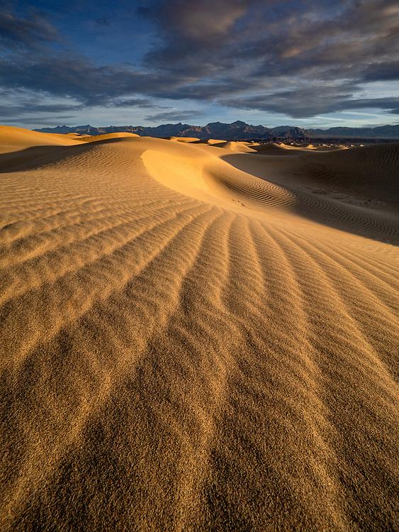 Sunrise illuminates the Mesquite Flats Sand Dunes in Death Valley National Park, California